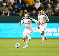 CARSON, CA – April 2, 2011: LA Galaxy midfielder David Beckham (23) moves the ball up the field during the match between LA Galaxy and Philadelphia Union at the Home Depot Center, March 26, 2011 in Carson, California. Final score LA Galaxy 1, Philadelphia Union 0.