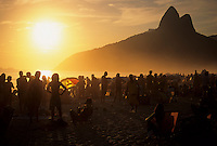 Sunset at Ipanema beach bathed in hazy afternoon light, Rio de Janeiro, Brazil.