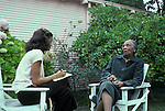 Berkeley CA  Eldery woman in her eighties telling her history to teen interviewer  MR