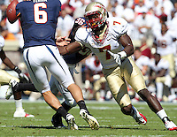 Oct 2, 2010; Charlottesville, VA, USA; Florida State Seminoles linebacker Christian Jones (7) puts pressure on Virginia Cavaliers quarterback Marc Verica (6) during the game at Scott Stadium. Florida State won 34-14.  Mandatory Credit: Andrew Shurtleff
