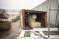 """""""Cow head #2"""" is seen stored in a lot at Hudson River Park in New York City on Sunday, March 30, 2014.  The architectural ornament along with numerous others is being stored in a lot in the park for future use in the complex park. The terra-cotta cow heads were originally from the New York Butchers' Dressed Meat Company  prior to its demolition. These artifacts and others were part of the Landmarks Preservation Commission's salvage program which was discontinued in 2000. Some of the salvaged material was given away to Hudson River Park.  (© Richard B. Levine)"""
