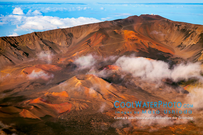 aerial view of Haleakala Crater, showing a number of large volcanic cinder cones, hiking trails and Haleakala Observatory at summit, Haleakala National Park, Haleakala or East Maui Volcano, Maui, Hawaii, USA