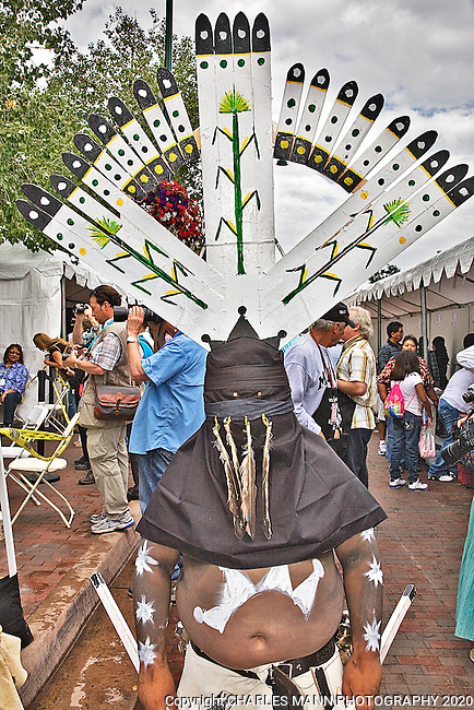 The 90th annual Santa Fe Indian Market was held on the plaza in August, New Mexico, and is the largest Native American art event in the world. A young White Mountian Apache Crown Dancer was part of the Native American Clothing Contest.