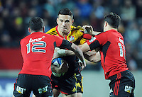 Chiefs Sonny Bill Williams, centre, attempts to bust the defence of the Crusaders Ryan Crotty left and Dan Carter in the Super 15 Rugby semi final match, Waikato Stadium, New Zealand, Friday, July 27, 2012. Credit:SNPA / Ross Setford