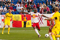 Jamison Olave (4) of the New York Red Bulls shoots and scores the game tying goal. The New York Red Bulls and the Columbus Crew played to a 2-2 tie during a Major League Soccer (MLS) match at Red Bull Arena in Harrison, NJ, on May 26, 2013.