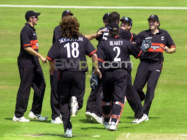 Pix: Simon Wilkinson/SWpix.com. Cricket. Yorkshire County Cricket Club. Season 2003. Twenty Twenty Cup. Yorkshire Phoenix v Debyshire Scorpions. 14/06/03...COPYRIGHT PICTURE>>SIMON WILKINSON>>01943 436649>>..Yorkshire celebrate their first Twenty Twenty win..