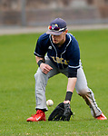 TORRINGTON, CT-042017JS07- Wolcott Tech's Jimmie Lamanna (17) field the ball in center field during their game against Harding Wednesday at Fuessenich Park in Torrington. <br /> Jim Shannon Republican-American