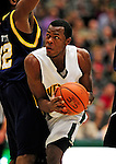 13 December 2009: University of Vermont Catamounts' forward Marqus Blakely, a Senior from Metuchen, NJ, looks for an opening against the Quinnipiac University Bobcats at Patrick Gymnasium in Burlington, Vermont. Blakely scored a career-high 32-point game as the Catamounts defeated the visiting Bobcats 80-77 to mark the Cats' season home opener with a win. Mandatory Credit: Ed Wolfstein Photo