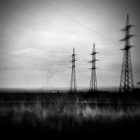 Electric towers seen from the train passing through the industrial area in the north of the Czech Republic, 4 September 2013. The whole nothern region of the country constantly suffers environmental impacts from the coal mining and the coal-fired energy production.