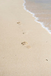 Footprints are left in the pristine white-gold sand of one of the beaches at ANA InterContinental Manza Beach Resort in Onna Village, Okinawa Prefecture, Japan, on Saturday, June 23, 2012. Photographer: Robert Gilhooly