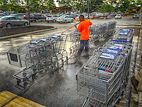 Shopping carts being cleaned outside Kroger on Schrock Road.