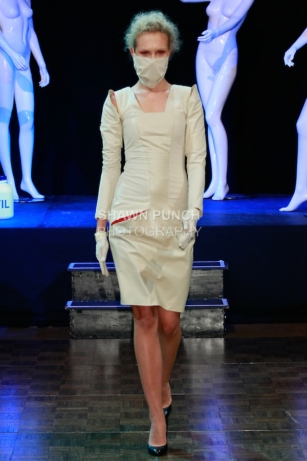 "Model walks runway in an outfit from the ""Clinical"" collection by Libor Komonsy from the Academy of Fine Arts and Design in Bratislava, during Slovak Fashion Night 2012 in New York City May 11, 2012."