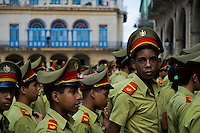 Young Cuban boys, students of the Camilo Cienfuegos Military School, wait in a line in Havana, Cuba, 4 February 2009. About 50 years after the national rebellion, led by Fidel Castro, and adopting the communist ideology shortly after the victory, the Caribbean island of Cuba is the only country in Americas having the communist political system. Although the Cuban state-controlled economy has never been developed enough to allow Cubans living in social conditions similar to the US or to Europe, mostly middle-age and older Cubans still support the Castro Brothers' regime and the idea of the Cuban Revolution. Since the 1990s Cuba struggles with chronic economic crisis and mainly young Cubans call for the economic changes.