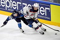 American Brady Skjei (R) and Finland's Veli-Matti Savinainen fight for the puck during tHe Ice Hockey World Championship quarter-final match between the US and Final in the Lanxess Arena in Cologne, Germany, 18 May 2017. Photo: Monika Skolimowska/dpa /MediaPunch ***FOR USA ONLY***