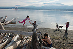 Girl jumps, guy catches, kid climbs, boy throws, dog waits, mom snaps.    Ediz Hook, Port Angeles WA