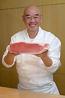Sushi chef Mitsuhiro Araki holding a slab of tuna. The Araki, London, UK, December 16, 2014. Following the success of his Three-Michelin-Star restaurant in Tokyo's Ginza, in 2014 Araki relocated to London.