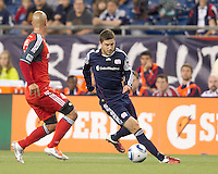 New England Revolution midfielder Chris Tierney (8) dribbles under pressure. In a Major League Soccer (MLS) match, the New England Revolution tied Toronto FC, 0-0, at Gillette Stadium on June 15, 2011.