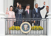 From left to right: Madame Peng Liyuan of China, First Lady Michelle Obama, President XI Jinping of China and United States President Barack Obama wave to invited guests from the Blue Room balcony to conclude an official State State arrival ceremony  on the South Lawn of the White House in Washington, DC on Friday, September 25, 2015.<br /> Credit: Ron Sachs / CNP