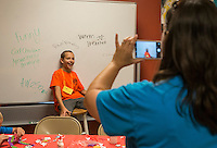 "NWA Democrat-Gazette/ANTHONY REYES • @NWATONYRTate Hinkle, 10, (seated) gets his picture taken Monday June 22, 2015 during the ""Vacation Bible School Xtreme"" at Robinson Avenue Church of Christ in Springdale. The students were getting their photos made after other campers wrote positive messages about them on the board around them. The theme of the program is building each other up and the nights focus was on using words to do that."