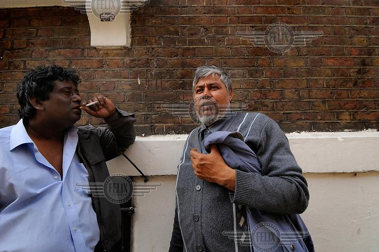 Bangladeshi men on Brick Lane, in London's East End.