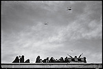 Armed Forces helicopters fly over the capital as crowds await the return of the Ayatollah Khomeini. Tehran, February 1, 1979.