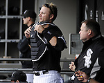 CHICAGO - OCTOBER 03:  A.J. Pierzynski #12 of the Chicago White Sox takes off his catchers equipment after being removed from the game against the Cleveland Indians on October 03, 2010 at U.S. Cellular Field in Chicago, Illinois.  The White Sox defeated the Indians 6-5.  (Photo by Ron Vesely)