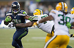 Seattle Seahawks running back Marshawn Lynch (24) rushes for  against the Green Bay Packers in the NFL Kickoff held at CenturyLink Field in September 4, 2014 in Seattle.      Seattle beat Green Bay 36-16. ©2014  Lynch rushed for 110 yards and score two touchdown as  Seattle beat Green Bay 36-16. ©2014  Jim Bryant Photo. ALL RIGHTS RESERVED.