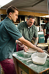 WATERTOWN, CT- 19 May 2016-051916EC11-  Jay Tranberg and Joe Elcuri, with the Big Green Pizza Truck out of New Haven, put toppings on a pizza ready for the oven during the Greater Waterbury Campership Fund's annual fundraiser Thursday night. The event was held at the Greater Waterbury YMCA's Camp Mataucha in Watertown. All money raised goes directly to the cost of sending children to camp. Erin Covey Republican-American