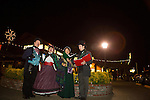 The Merrie Olde Christmas Carolers entertain guests at the Rancho Shopping Center in Los Altos Dec. 7 during a tree lighting ceremony.