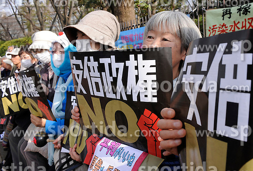 People attend a demonstration against Japanese Prime Minister Shinzo Abe in Tokyo, Japan, March 22, 2015. EXPA Pictures &copy; 2015, PhotoCredit: EXPA/ Photoshot/ Stringer<br /> <br /> *****ATTENTION - for AUT, SLO, CRO, SRB, BIH, MAZ only*****