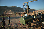 13/11/2015--Iraq,Sinjar -- Filling water tanks for those peshmarga forces that been placed in the mountain of Sinjar.