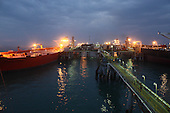AL-BASRA OIL TERMINAL, IRAQ: Two tankers are loaded with crude at the off shore loading facility at the Basra Oil Terminal..