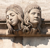 Two womens head Gargoyle below Magdalen Great Tower, part of Magdalen College, Oxford University, England.