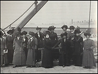 BNPS.co.uk (01202 558833)<br /> Pic: HAldridge/BNPS<br /> <br /> Mabel Bennett, a first class stewardess (6th from left) wearing the coat on SS Lapland two weeks later.<br /> <br /> A fur coat which helped keep a Titanic survivor warm in the aftermath of the disaster that was unearthed 105 years later - has sold for a staggering &pound;181,000.<br /> <br /> Mabel Bennett, a first class stewardess on the doomed liner, grabbed the thick garment from her room before climbing into a lifeboat as the ship gradually sank in the icy Atlantic.<br /> <br /> Mabel still had the coat with her days later when she was photographed wearing it while on board the SS Lapland, the ship that took all the surviving Titanic crew members back to England.<br /> <br /> Mabel, from Southampton, kept the beaver lamb sheepskin coat for the next 50 years until she gave it to her great niece because it became too heavy for her to wear in her old age.