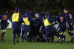 13 November 2009: Virginia players pile on goalkeeper Diego Restrepo after the game. The University of Virginia Cavaliers defeated the Wake Forest University Demon Deacons 4-3 on penalty kicks after the game ended in a 0-0 tie after overtime at WakeMed Stadium in Cary, North Carolina in an Atlantic Coast Conference Men's Soccer Tournament Semifinal game.
