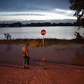 DOBRZYKOW, POLAND, MAY 24, 2010:.Villager on early morning, observing rising waters..The latest chapter of disastrous floods in Poland has been opened yesterday, May 23, 2010, after Vistula river broke its banks and flooded over 25 villages causing evacualtion of most inhabitants..Photo by Piotr Malecki / Napo Images..DOBRZYKOW, POLSKA, 24/05/2010:.MIeszkaniec obserwuje podnoszaca sie wode wczesnym rankiem . Najnowszy akt straszliwych tegorocznych powodzi zostal rozpoczety wczoraj gdy Wisla przerwala waly na wysokosci wsi Swiniary kolo Plocka..Fot: Piotr Malecki / Napo Images ..