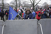 WARSAW, POLAND, DECEMBER 20, 2016:<br /> Man with EU flag looking over the riot fence guarding the Sejm, Polish parliament building, during anti government demonstration.<br />  The opposition objects to government plans to limit the number of journalists allowed to cover parliamentary proceedings. The MPs' protest delayed a budget vote, which was later held away from the main parliament chamber. (Photo by Piotr Malecki / Napo Images) **** WARSZAWA, 20.12.2016. Demonstracja opozycji pod sejmem w obronie wolnosci mediow Fot. Piotr Malecki / Napo Images ###ZDJECIE MOZE BYC UZYTE W KONTEKSCIE NIEOBRAZAJACYM OSOB PRZEDSTAWIONYCH NA FOTOGRAFII### ### Cena zdjecia w/g cennika FORUM plus 50% (cena minimalna 100 PLN)