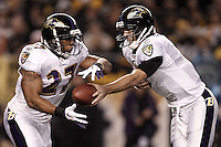 PITTSBURGH, PA - NOVEMBER 06:  Joe Flacco #5 of the Baltimore Ravens hands the ball off to teammate Ray Rice #27 against the Pittsburgh Steelers during the game on November 6, 2011 at Heinz Field in Pittsburgh, Pennsylvania.  (Photo by Jared Wickerham/Getty Images)
