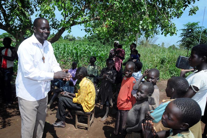 UGANDA BRAILLE BIBLE CASE STUDIES. REV RICHARD OPIO, 45,  IN DOKOLO,  UGANDA. PHOTO BY CLARE KENDALL. 25/9/13