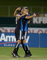 Mike Wondolowski (left) celebrates with Jason Hernandez (right) after Hernandez's game winning shot. The San Jose Earthquakes defeated Chivas USA 6-5 in shootout after drawing 0-0 in regulation time to win the inagural Sacramento Cup at Raley Field in Sacramento, California on June 12, 2010.