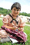 MADELYN WALKER, 7, of Levittown, NY, wears clothes of American Civil War era while portraying family members of Union soldiers at Camp Scott re-creation, at Old Bethpage Village Restoration, to commemorate 150th Anniversary of American Civil War, on Saturday, July 21, 2012, in Old Bethpage, New York, USA.
