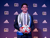 #5 overall pick Eric Miller of the Montreal Impact stands on the podium during the MLS SuperDraft at the Pennsylvania Convention Center in Philadelphia, PA, on January 16, 2014.
