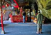 The red altar at the end of the cave temple complex at Goa Giri Putri on Nusa Penida, Bali, Indonesia