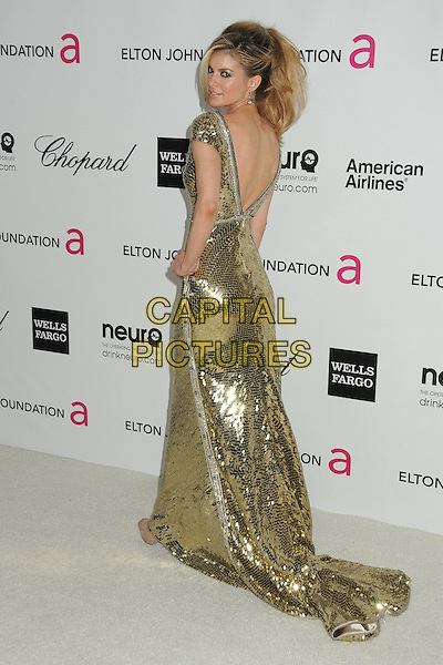 Marisa Miller.20th Annual Elton John Academy Awards Viewing Party held at West Hollywood Park, West Hollywood, California, USA..February 26th, 2012.oscars full length dress hand on hip gold sequins sequined backless back behind rear.CAP/ADM/BP.©Byron Purvis/AdMedia/Capital Pictures.