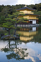 Kinkakuji was built in 1393 as a retirement villa for Shogun Yoshimitsu Ashikaga.  He intended to cover the exterior with gold, but only managed to coat the third floor with gold leaf before his death.  After his death, his son converted the building into a Zen temple of the Rinzai school named Rokuonji in accordance with Ashikaga's wishes.