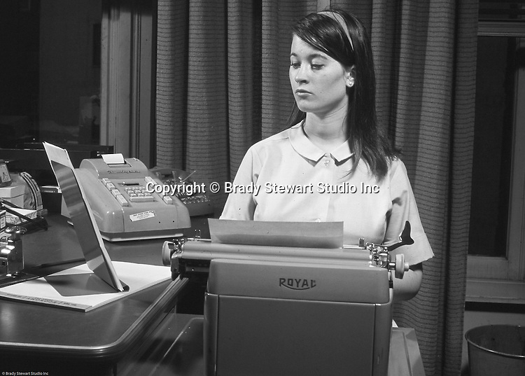 Pittsburgh PA:  View of a secretary typing a letter - 1967.  Cathy Stewart working in the offices of the National Union Insurance Company.  Cathy left Pittsburgh for New York City in 1969.  Over the next twenty years, she established herself as one of the top advertising executives in New York City.  Working for American Home Products, a few advertising agencies before becoming the highest ranking woman at Shearson Lehman, American Express (VP of Marketing).