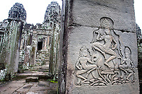 Reliefs show apsaras, the divine dancers, engraved in Bayon temple, in Angkor, Cambodia, on October 9, 2009. The Bayon temple was built in the late 12th century or early 13th century as the official state temple of the Mahayana Buddhist King Jayavarman VII. Angkor used to be the seat of the Khmer empire, which flourished from approximately the ninth century to the thirteenth century. The ruins of Angkor temples are a UNESCO World Heritage Site. Photo by Lucas Schifres/Pictobank.