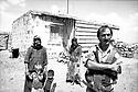 Turquie 1997..Une famille kurde du village de Oçakli prés de Ani, devant leur maison..Turkey 1997.A Kurdish family in front their house in a village near Ani