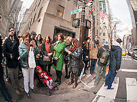 Tourists on Fifth Avenue in New York on Sunday, December 14, 2014. Christmas sales abound as there are only eleven shopping days left until the holiday. (© Richard B. Levine)