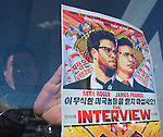 Merrick, New York, USA. December 25, 2014. The Interview, the controversial comedy by Sony Pictures Entertainment, plays at Merrick Cinemas, thought to be the only movie theater showing it in Nassau County, Long Island, on Christmas Day. A movie poster taped to the entrance window. In November, hackers hacked Sony Pictures computers, and later threatened theaters planning to show The Interview, in which stars James Franco and Seth Rogen play civilians recruited by CIA to assassinate North Korea dictator Kim Jong-un. Due to the terrorist threats, Sony originally canceled public release of the film, but then changed its plans again, and released the film in a limited way, including several hundred independent theaters, against the attempt to suppress the American First Amendment Right to Free Speech.